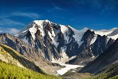 stock photo of rocky-mountains  - Landscape with rocky mountains and blue sky - JPG