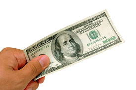 stock photo of one hundred dollar bill  - male hand holding a one hundred dollar bill  - JPG