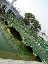pic of muharram  - wooden bridge over the garden canal with its reflection in water at chota imambada lucknow - JPG