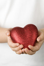 image of hand heart  - Red heart on child  hands - JPG