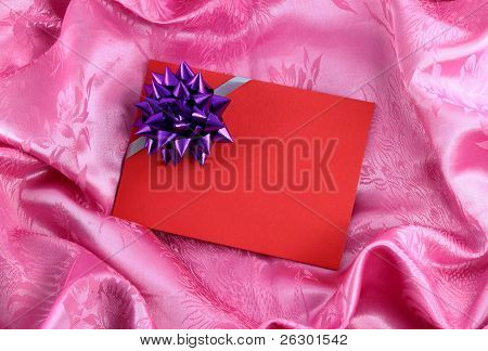 Red Blank Gift Card With Ribbon On Pink Satin