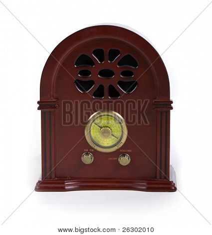 vintage wooden radio over white background