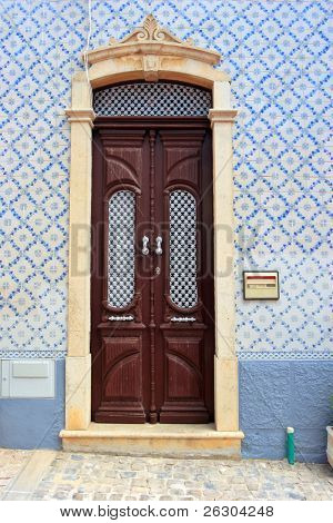 elaborate designed blue tiled doorway to house