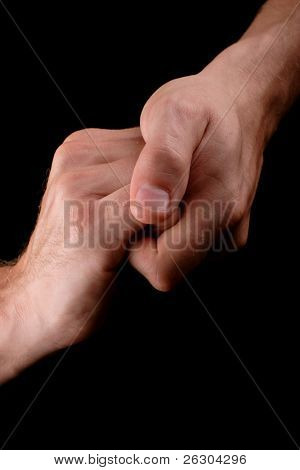 male hands clasped together