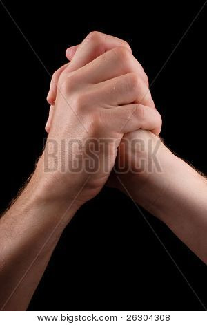 clasped hands in position of success