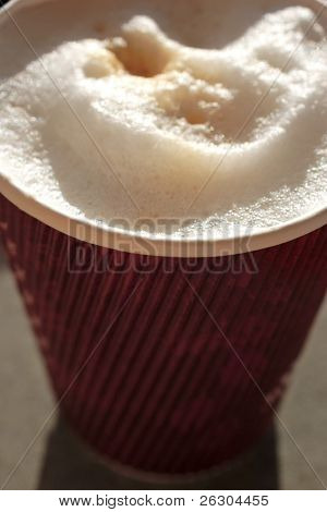 frothy coffee in disposable cup,recycle.