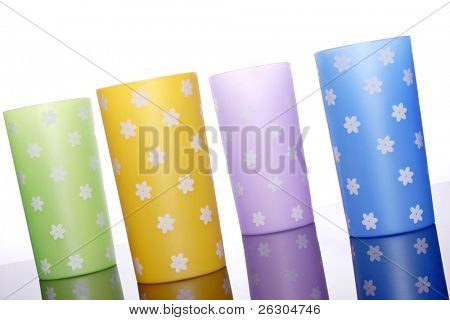 four brightly colored plastic drinking tumblers