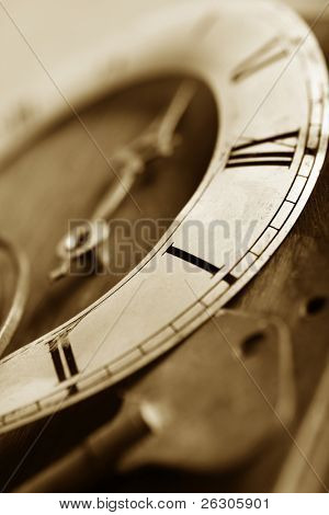 old worn clock, sepia toned