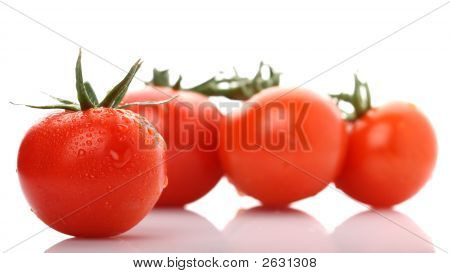 Perfect Red Wet Tomato With Three Tomatoes On Background