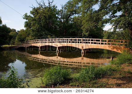Old wooden bridge over water in the castle park