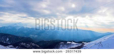Winter mountain landscape with color slanting beam of light, Sochi, Russia