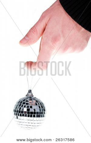 hand and mirror ball on finger