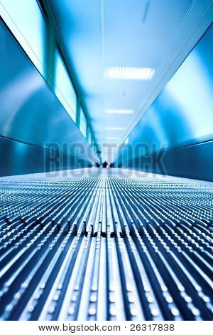 Blue moving escalator in the office hall perspective view
