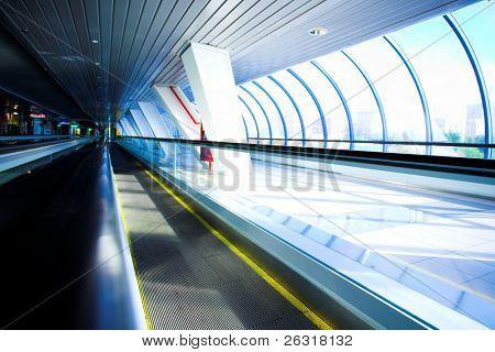 Empty escalator in corridor in office centre