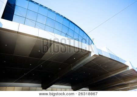 Modern blue office building windows under enter doors