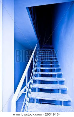 View to blue empty staircase in destroyed building