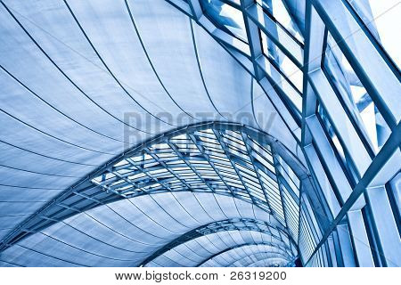 Abstract blue ceiling interior background, left composition