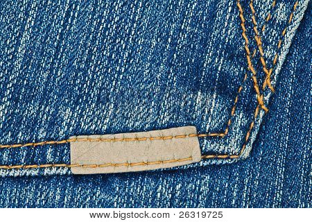 Small leather label on blue jeans pocket