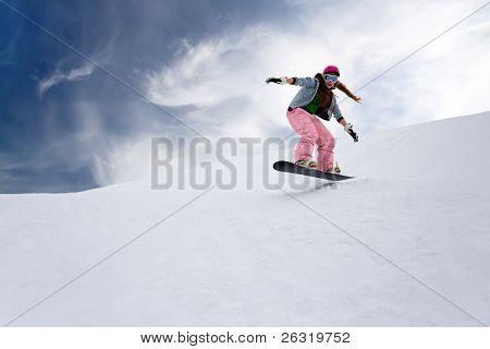 Girl rider jump on snowboard