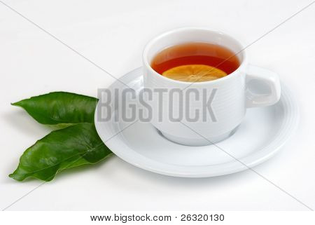 Tea cup and green leaves of lemon isolated on white background