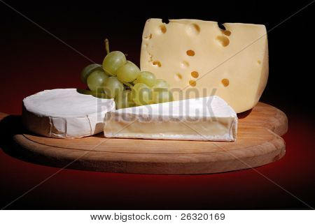 Grapes and Cheese on a wooden cheese board