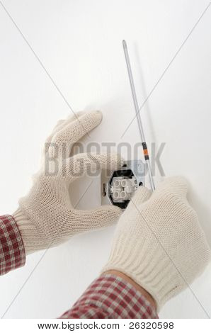 man installing electrical box