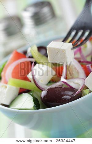 Greek salad with kalamata olives in the bowl closeup
