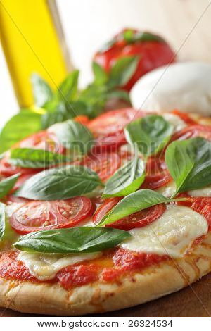 Margherita pizza with mozzarella, tomato, and basil