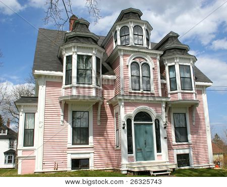 An old heritage home painted the unlikely shade of pink.