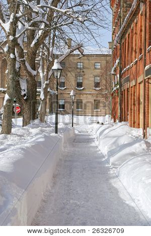 A sidewalk plowed of snow in the downtown area of Charlottetown, Prince Edward Island.