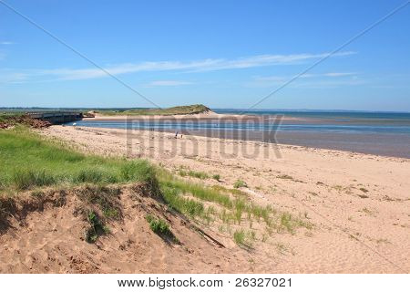 A long stretch of Dalvay Beach in Cavendish National Park, Prince Edward Island, Canada.