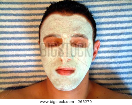 Young Man With A Facial Treatment