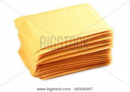 A stack of bubble padded envelopes on a white background..
