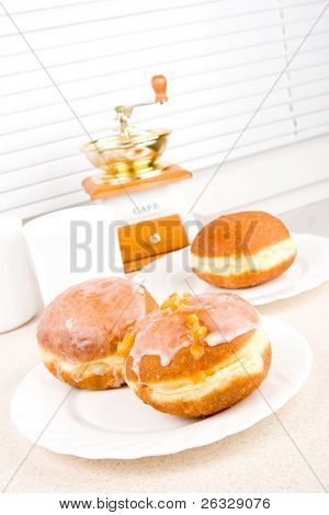 A tasty icing donuts on the bright background.