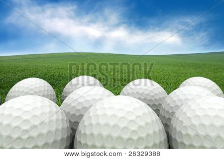Golf balls on the grass background