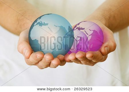 A semitransparent globes in hands