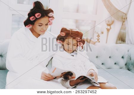 poster of Little Lady With Curlers. Happy Child In Beauty Salon. Consept Beauty Salon. Little Lady. Girl And W