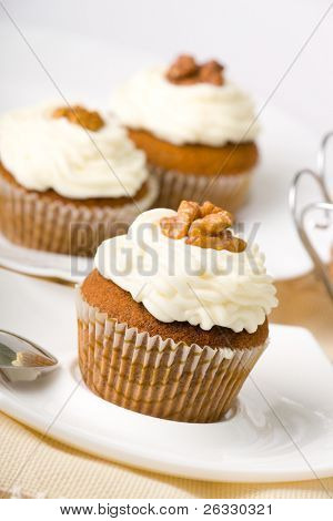 Walnuts muffins with mascarpone cheese (whipped cream).