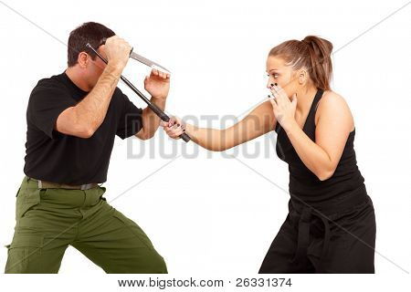 Man and woman practice fight using knife and truncheon