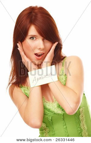 Beautiful woman with 'amazed' sticky note attached to her shirt