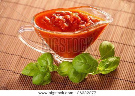 Italian pasta tomato sauce with fresh basil