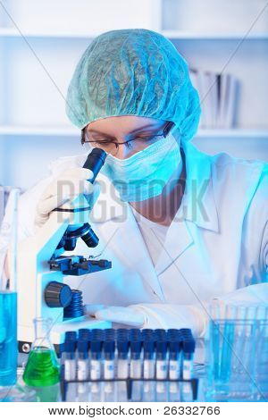 Scientific researcher using a microscope in a laboratory