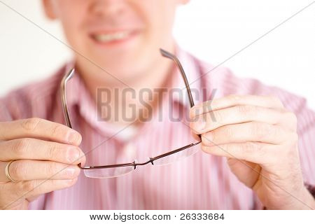 Male optician oculist presenting new glasses