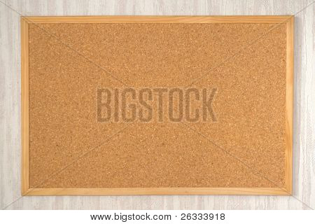 Empty cork board on the wall