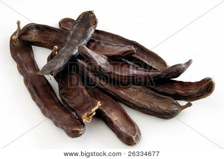 carob brown husks as mediterranean condiment for food or confectionery