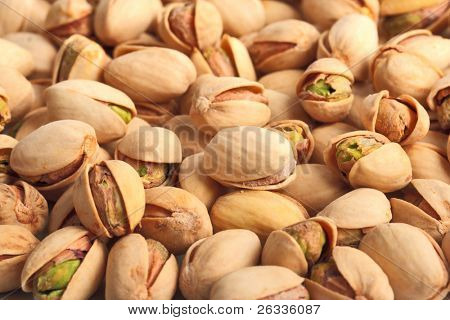 Pile of pistachio nuts close up