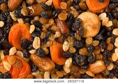 Various dried fruits (apricots, dates, raisins, figs) close-up