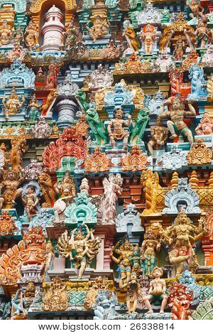 Sculptures on Hindu temple gopura (tower). Jambukeshwarar temple. Madurai, Tamil Nadu, India