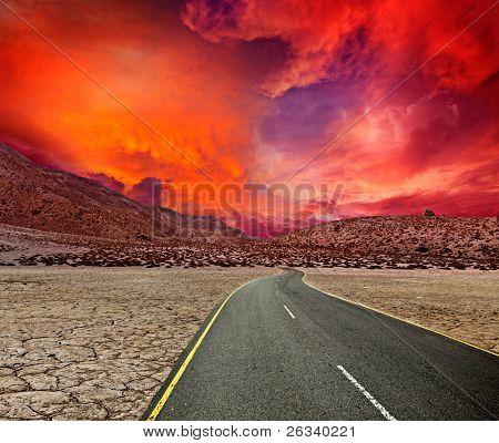 Road in desert on sunset