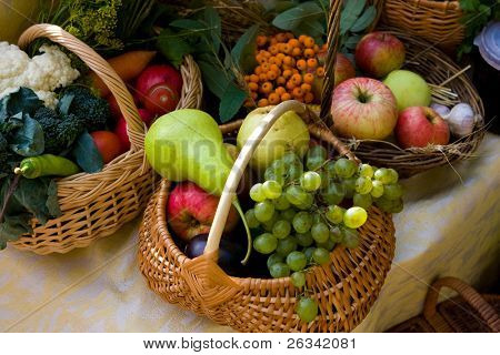 Autumn market - fresh fruits and vegetables in the baskets